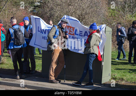 Hartlepool, UK. 17th March 2019. Brexit supporters on the second leg of the March to Leave walk from Hartlepool to Middlesbrough. Nigel Farage was not in attendance.The marchers take a breather at the resting point. Credit: David Dixon / Alamy Live News - Stock Photo