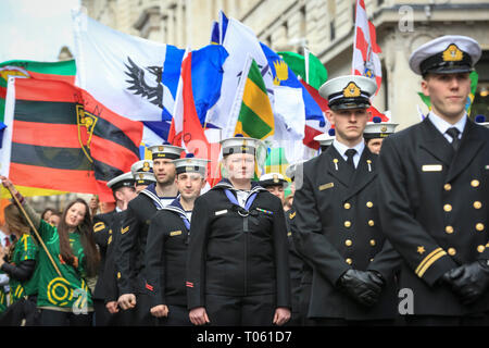 London, UK, 17th Mar 2019. Members of the L.E. James Joyce Irish Naval Service with colourful flags. Now in its 17th year, the parade attracts more than 50,000 people for a colourful procession of Irish marching bands from the UK, US and Ireland, energetic dance troupes and spectacular pageantry. Credit: Imageplotter/Alamy Live News - Stock Photo