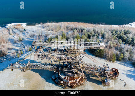 22 January 2019, Saxony-Anhalt, Gräfenhainichen: The disused bucket wheel excavator 'Big Wheel' stands in 'Ferropolis', the city made of iron (taken with a drone). A total of five large machines from the former Golpa-Nord open-cast mine were set up here in an orderly fashion and have been setting the stage for an event area with its unique backdrop since 1995. In addition to concerts, several festivals take place here every year. Above all, they are responsible for a steady increase in the number of visitors. Photo: Jan Woitas/dpa-Zentralbild/ZB - Stock Photo