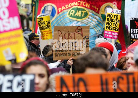 London, UK, UK. 16th Mar, 2019. A protester seen holding a placard during the demonstration.Thousands of people with placards and banners are seen marching against racism to mark UN World against Racism global day of action. The terrorist attack on a mosque in Christchurch, New Zealand on Friday 15 March 2019 that left 50 dead is a reminder that the global anti-racist movement must take urgent action. Credit: Dinendra Haria/SOPA Images/ZUMA Wire/Alamy Live News - Stock Photo