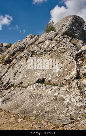 Hieroglyphics on rock face, Hattusa (also Ḫattuša or Hattusas) late Anatolian Bronze Age capital of the Hittite Empire. Hittite archaeological site an - Stock Photo