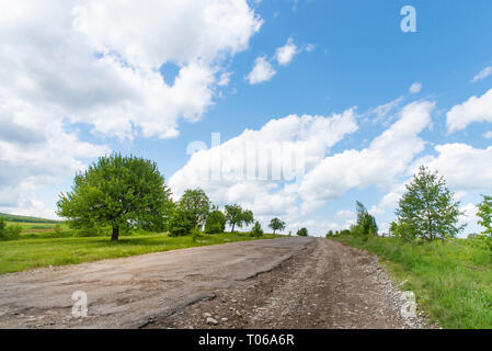 Completely destroyed road, difficult traffic area, threat of damage to vehicle - Stock Photo