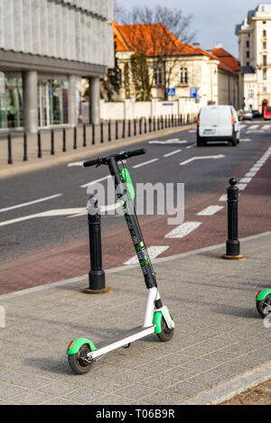 Electric scooter parked on the road. Warsaw Poland. February 18, 2019. - Stock Photo