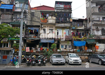 Hanoi, Vietnam - 14th December 2017. Houses on a residential street which is often referred to as Train Street in central Hanoi which has grown up aro - Stock Photo
