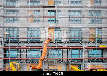 scaffolding on  house facade,  building under construction - Stock Photo