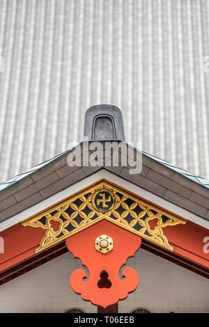Gegyo 懸魚 (Gable Pendant), crooked cross and Kazarikanagu 飾金具 (Metal ornaments) roof ridge deatil at Senso-ji tempple. Located in Asakusa, Tokyo, Japan - Stock Photo