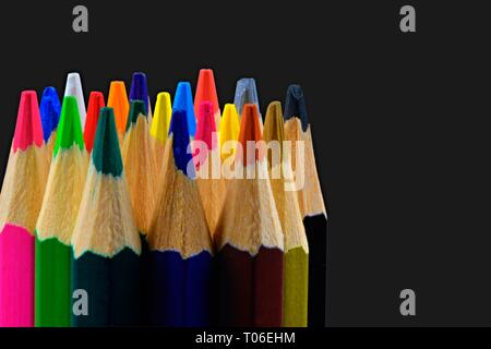 Close up of an assortment of colored pencils tips on black background. Background of colorful pencils. Creative idea and concept. Drawing and painting - Stock Photo