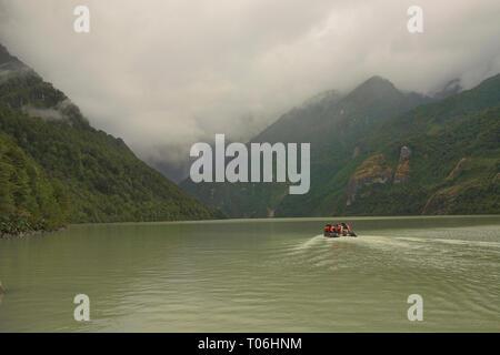 Sightseeing boat on Laguna Tempanos in Queulat National Park, Patagonia, Aysen, Chile - Stock Photo