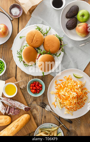 Vegetarian burgers with different foods. Vegetarian food is not only. Summer party food concept top view. Various food on table flat lay - Stock Photo