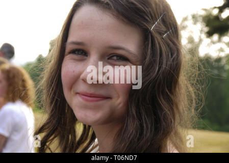 Young girl at a prom in a white dress, UK - Stock Photo