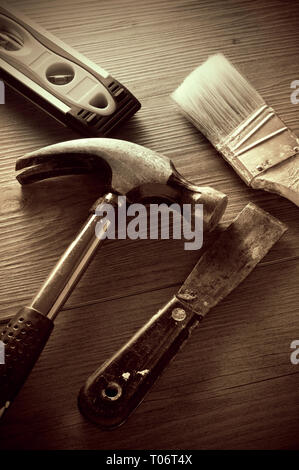 Vintage Looking Sepia Image of Tools on the Floor - Stock Photo