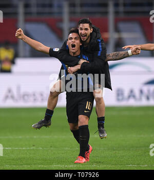 Milan, Italy. 17th Mar, 2019. Inter Milan's Lautaro Martinez (bottom) celebrates during a Serie A soccer match between AC Milan and Inter Milan in Milan, Italy, March 17, 2019. Credit: Alberto Lingria/Xinhua/Alamy Live News - Stock Photo
