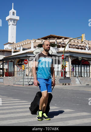 Palma, Spain. 16th Mar, 2019. Eneko from Madrid walks across a street with a suitcase. He'll be working all season in a discotheque. Mallorca is preparing for the start of the season at the end of April - but this year the Palma Municipality has declared war on booze tourism. (to dpa 'New season, new rules: 'Excess light' at Playa de Palma') Credit: Clara Margais/dpa/Alamy Live News - Stock Photo