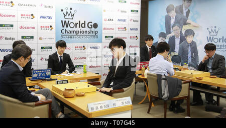 Tokyo, Japan. 18th Mar, 2019. Players compete during the quarterfinal match of World Go Championship 2019, in Tokyo, Japan, on March 18, 2019. Credit: Jiang Yucen/Xinhua/Alamy Live News - Stock Photo