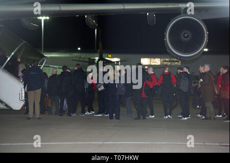 Glasgow, UK. 18 March 2019. Alex McLeish - Scotland Team Football Manager Alex McLeish (2nd from right) and the Scotland Football Team seen boarding their luxury jetliner private aircraft in the early hours seen  at Glasgow Airport moments before departing for Kazakhstan to play a game on Wednesday.  The flight was due to take off at 11pm, however due to an unforeseen problem where the pilot had to come out of the flight deck and onto the tarmac and speak with ground crew, the flight eventually took off in the early hours of today. Credit: Colin Fisher/Alamy Live News - Stock Photo