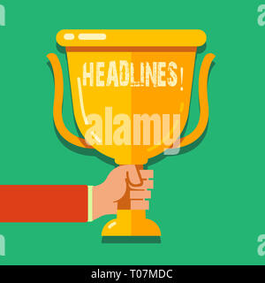 Word writing text Headlines. Business photo showcasing Heading at the top of an article in newspaper Hand Holding Blank Golden Championship Winners Cu - Stock Photo
