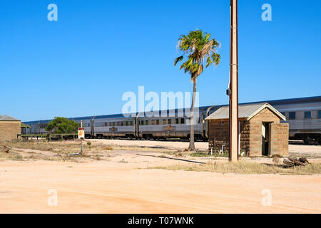 The Indian Pacific train service between Perth and Sydney, Australia, is seen at a stop at Rawlinna, Western Australia. - Stock Photo