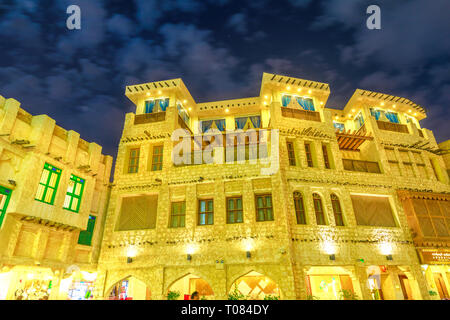 Doha, Qatar - February 18, 2019: historic building at Souq Waqif, old market in traditional Qatari architectural style at night. The souq is - Stock Photo