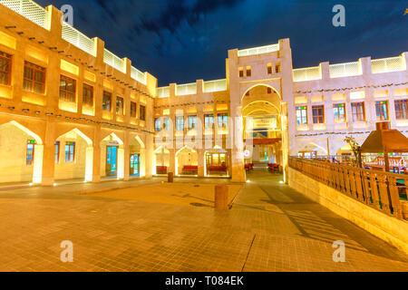 Doha, Qatar - February 18, 2019: facade of historic Falcon Souq building near Souq Waqif, a market selling live falcon birds and falconry equipment - Stock Photo