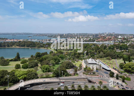 Looking down on The Conservatorium of Music Sydney and the Royal Botanic Gardens and then to Farm Cove and the greater Sydney Harbour (Harbor) - Stock Photo