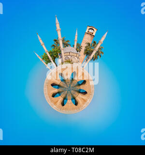 Tiny planet panorama of Adana city from Turkey. Sabanci Central Mosque, Old Clock Tower and Stone Bridge in Adana, city of Turkey. - Stock Photo