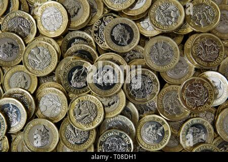 Pile of new UK One Pound Coins - Stock Photo