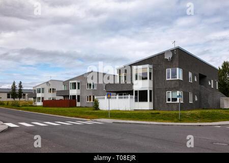 Egilsstadir, Iceland - Aug 2, 2015: Residential buildings on Skogarlond street - Stock Photo