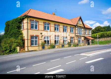 Historic inn by the main road in the small town Klemensker, Bornholm island, Denmark - Stock Photo