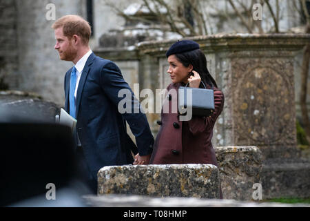 Harry and Meghan, Duke and Duchess of Sussex leave the christening of Zara and Mike Tindall's 2nd child Lena at St Nicholas Church in Gloucestershire. - Stock Photo