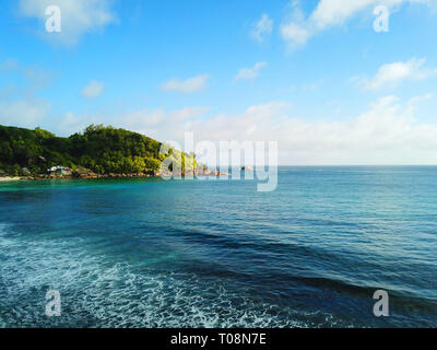 Indian Ocean and the coast of the Seychelles island Mahe at the beach of Takamaka. - Stock Photo