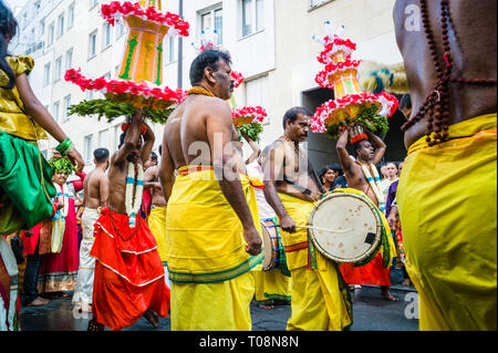 Upon Ganesh Chaturthi festival in Paris, celebrating the birth of Ganesha, bare-chested male dancers and musicians parade in a public procession. - Stock Photo