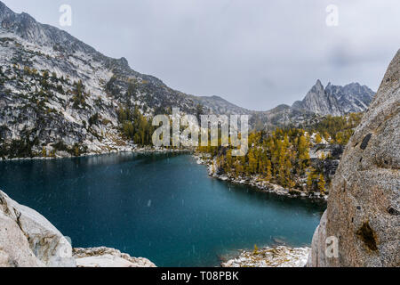 Inspiration Lake with Prusik Peak in the distance as a snow squall falls on the Enchantment Lakes Wilderness area in the Washington Cascade Mountains, - Stock Photo
