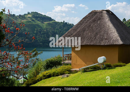 Deluxe chalet overlooking Nyinabulitwa Crater Lake at Crater Safari Lodge located close to Kibale Forest National Park, South West Uganda, East Africa - Stock Photo