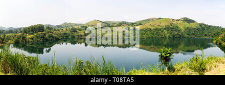 View of Nyinabulitwa Crater Lake from Crater Safari Lodge located close to Kibale Forest National Park, South West Uganda, East Africa - Stock Photo