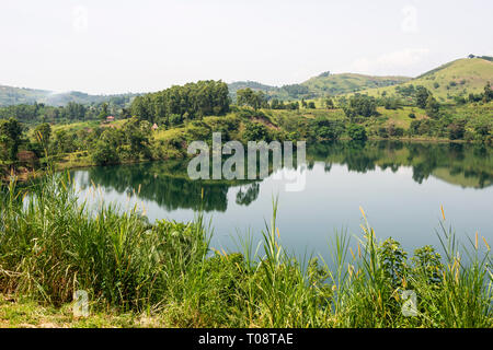 View of Nyinabulitwa Crater Lake from Crater Safari Lodge located close to Kibale Forest National Park, South West Uganda, East Africa Stock Photo