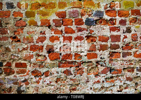 old repaired wall with brick texture - Stock Photo
