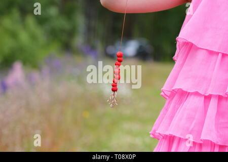 A straw with wild strawberries - Stock Photo