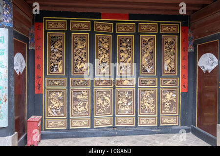 Carved wood doors Interior courtyard, Zhu Family house, Jianshui Ancient Town, Yunnan Province, China - Stock Photo