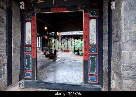 Carved wood doors Interior courtyard, Zhu Family house, Jianshui Ancient Town, Yunnan Province, China - Stock Photo
