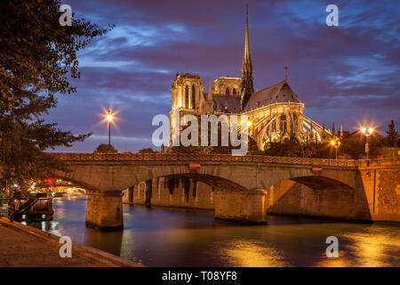 Twilight over Cathedral Notre Dame along River Seine, Paris, Ile-de-France, France - Stock Photo