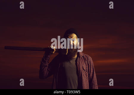 lumberjack hipster on twilight - Stock Photo