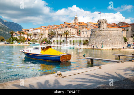 Beautiful view of the historic town of Korcula on a beautiful sunny day with blue sky and clouds in summer, Island of Korcula, Dalmatia, Croatia - Stock Photo