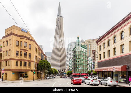 SEPTEMBER 3, 2016 - SAN FRANCISCO: Central San Francisco with famous Transamerica Pyramid and historic Sentinel Building at Columbus Avenue on a cloud
