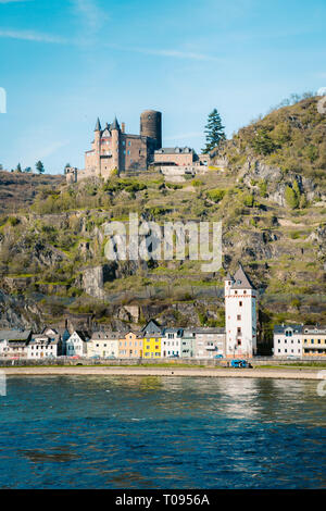 Beautiful view of the historic town of St. Goarshausen with famous Rhine river on a scenic sunny day with blue sky in spring, Rheinland-Pfalz, Germany - Stock Photo