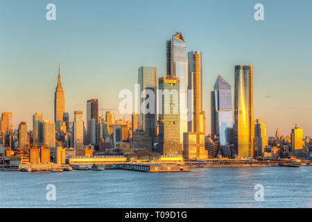 The mixed-use Hudson Yards real estate development and other buildings on the West Side of Manhattan in New York City at sunset. - Stock Photo