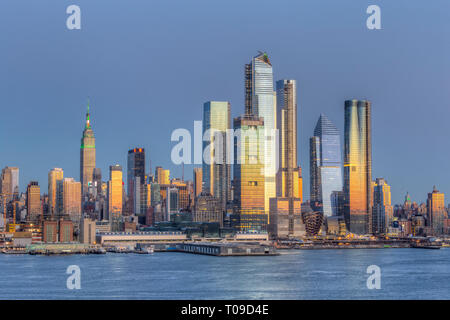 The mixed-use Hudson Yards real estate development and other buildings on the West Side of Manhattan in New York City at twilight. - Stock Photo