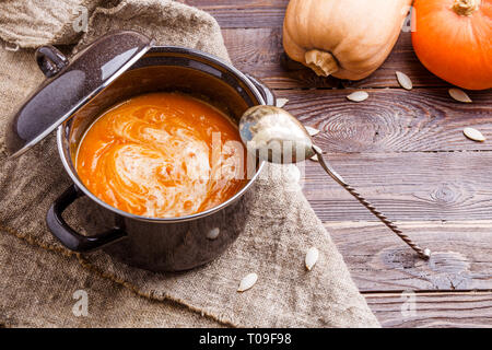 Photo of soup puree, pumpkin on linen cloth - Stock Photo