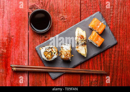 Sushi served on black board - Stock Photo