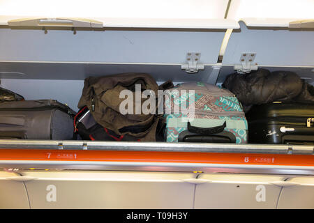 Overhead passenger locker / lockers / compartment / compartments for stowing passengers bags cabin luggage on an Easyjey Airbus A320 or  A319 plane. - Stock Photo