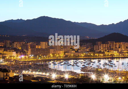 The houses of Ajaccio city and its marina at night , France, Corsica island. - Stock Photo